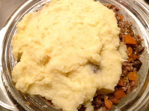 mit Kartoffelstampf überziehen